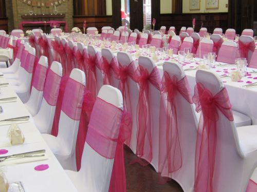 pink bows on chairs