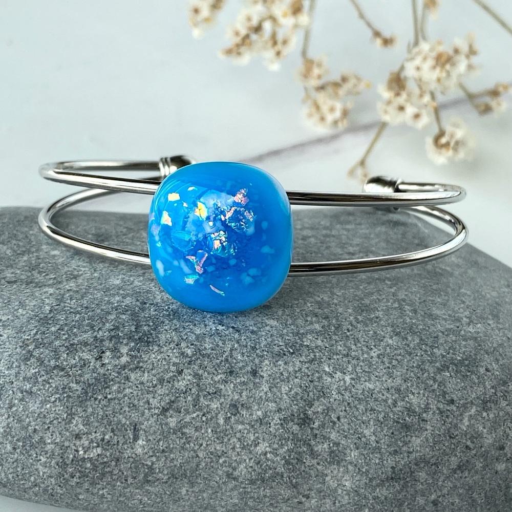 Coast blue bangle, silver-plated.