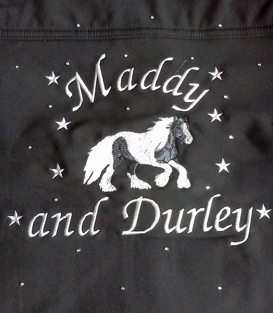 Jacket back with Italic lettering style and additional embroidered stars and crystal scatter