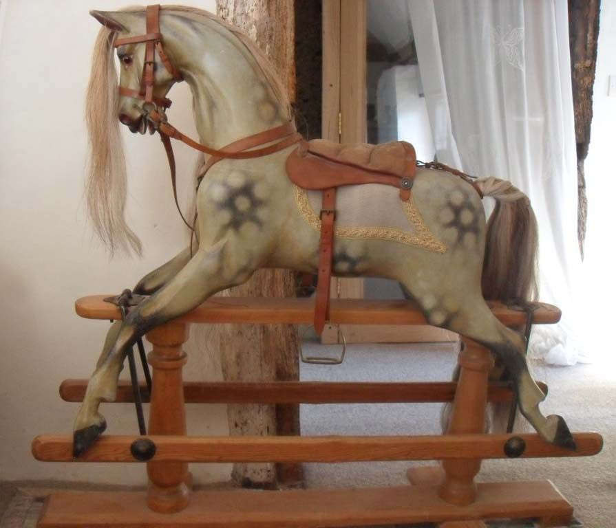Eve G&J Lines Carved Rocking Horse 39in