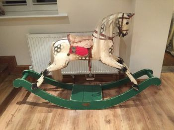 Rocking Horse Works Ex Carved On Green Bow
