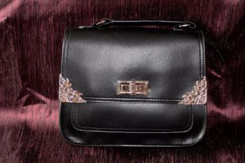 Small black shoulder/ hand bag with ornate gold corners