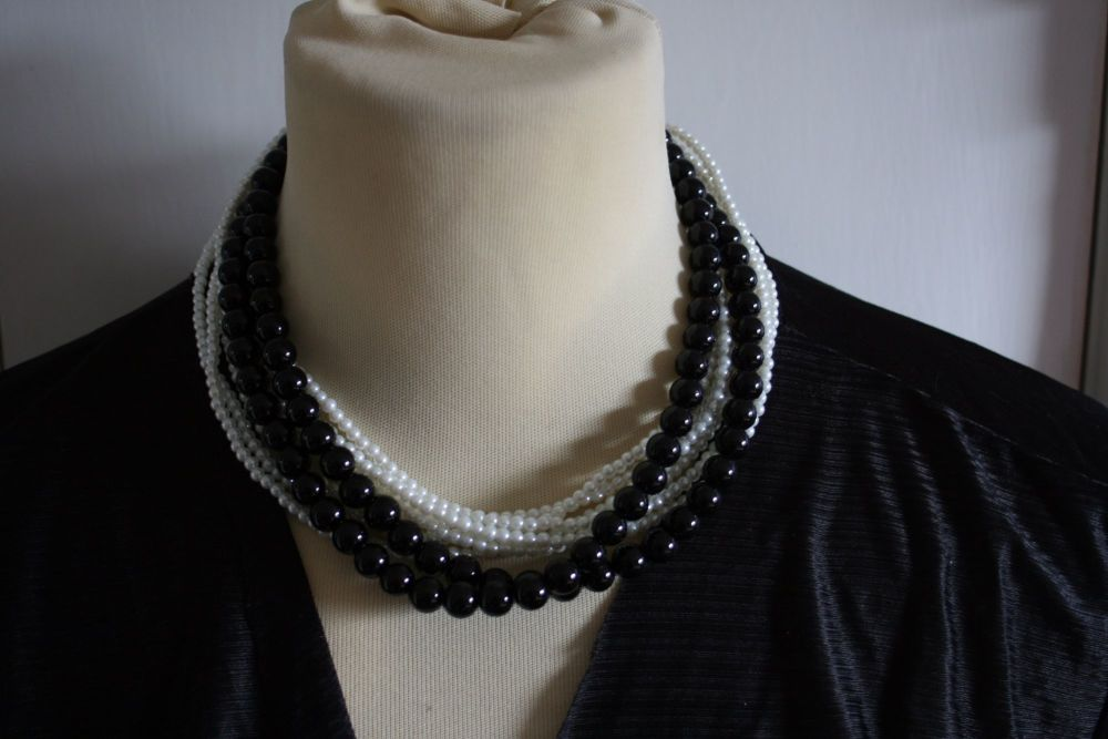 Black and white bead and faux pearl multi strand necklace