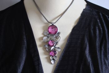 Silver tone and purple crystal articulated necklace