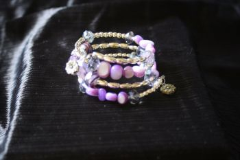 Purple self wrapping bracelet with charms