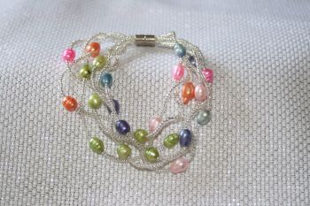 Delicate fine string seed bead bracelet with magnetic catch