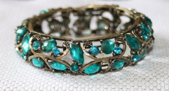 Turquoise blue crystal set in aged metal hinged bracelet