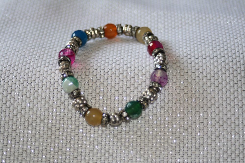 Elasticated bracelet in silver and multicolour stones