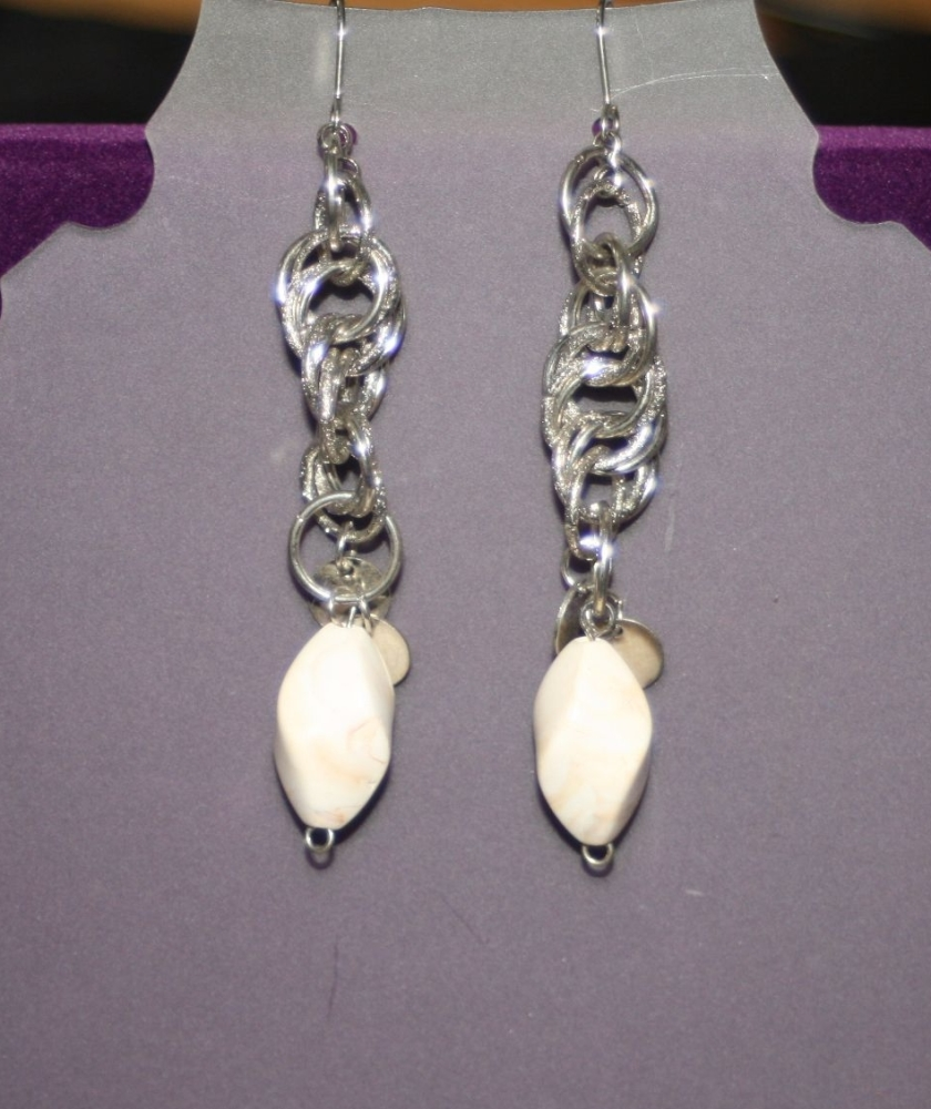 Dangling Silver Chains with White Detailing