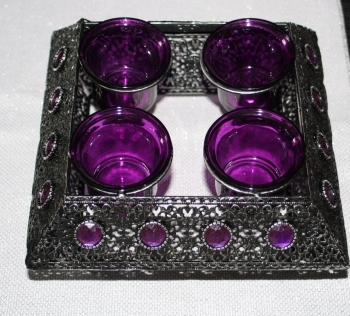 Black Metal Fretwork with four purple glass tealight holders