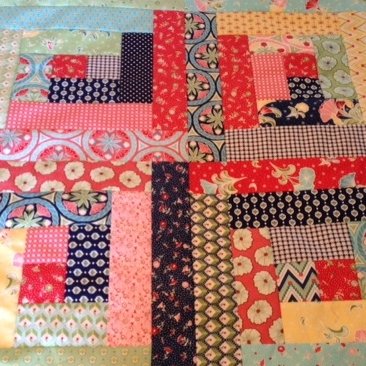 Jelly roll quilt top - log cabin