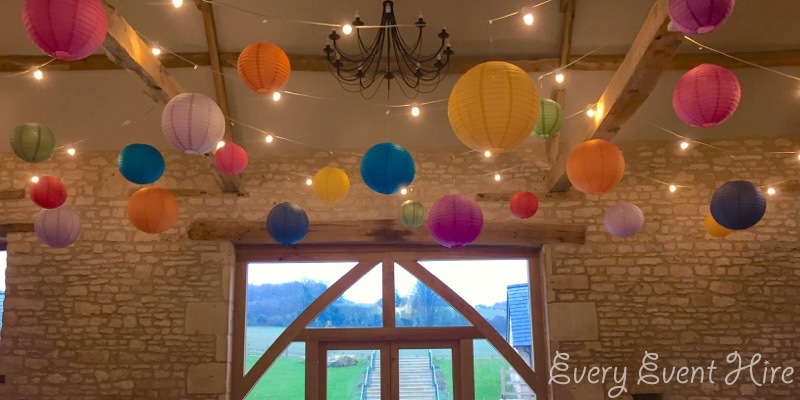 The Barn at Upcote Hanging Lanterns in Bright Colours