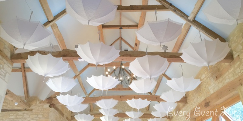 White Hanging Umbrellas at Barn at Upcote