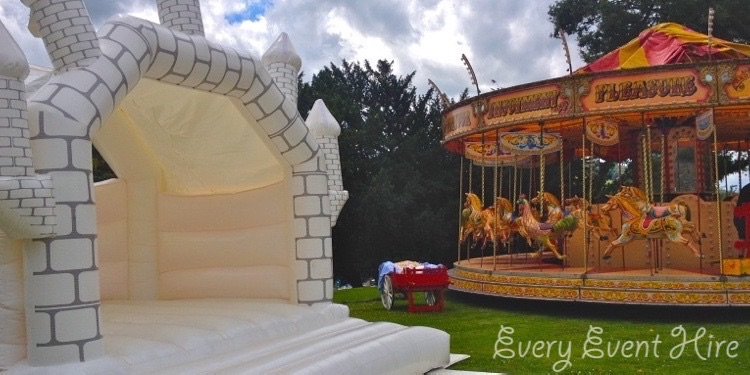 White Bouncy Castle with Vintage Merry Go Round