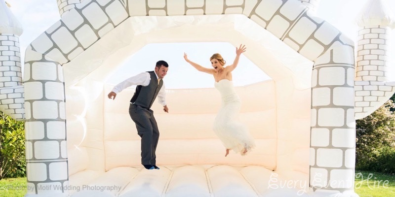White Wedding Bouncy Castle with Bride and Groom at Hyde Barn