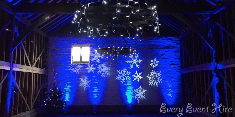 Snowflake Image Projection Over Barn