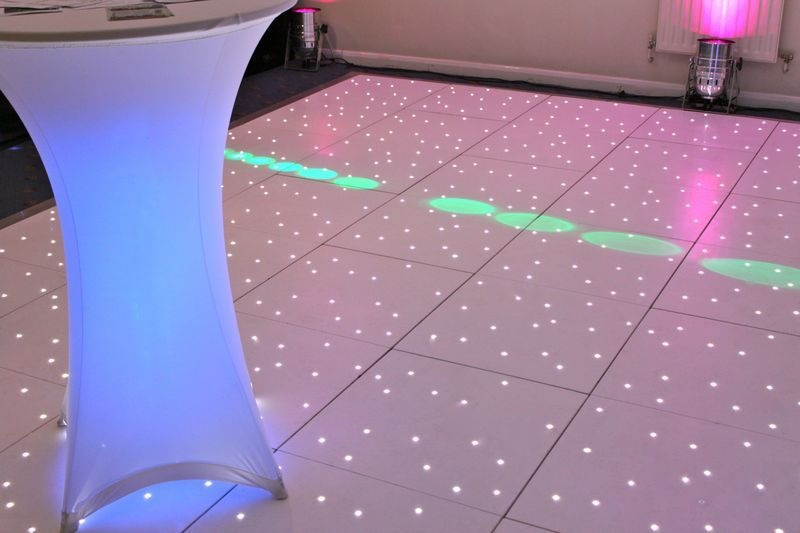 blue poseur table and white starlit dance floor