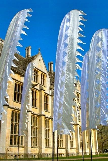 white wedding flags in front of woodchester mansion