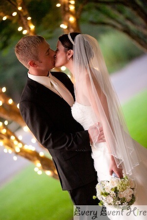 Outdoor Wedding Fairy Lights Bride and Groom Kissing