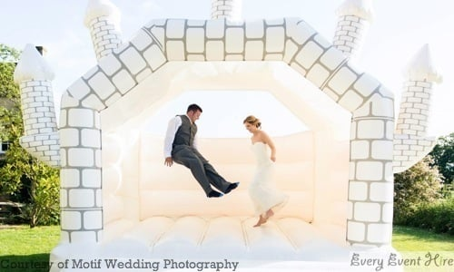 White Wedding Bouncy Castle with Groom and Bride at Hyde Barn