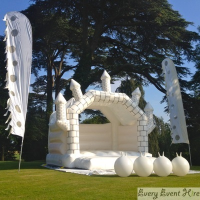 White Wedding Bouncy Castle with White Space Hoppers and White Flags