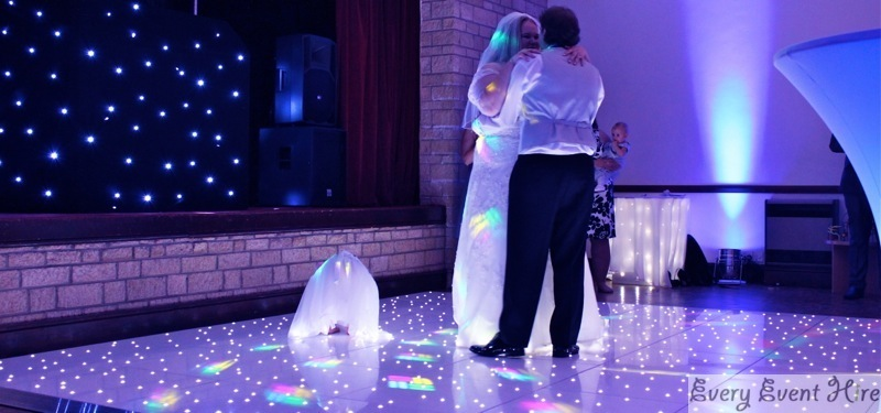 Bride and Groom with Daughter on Starlit Dance Floor