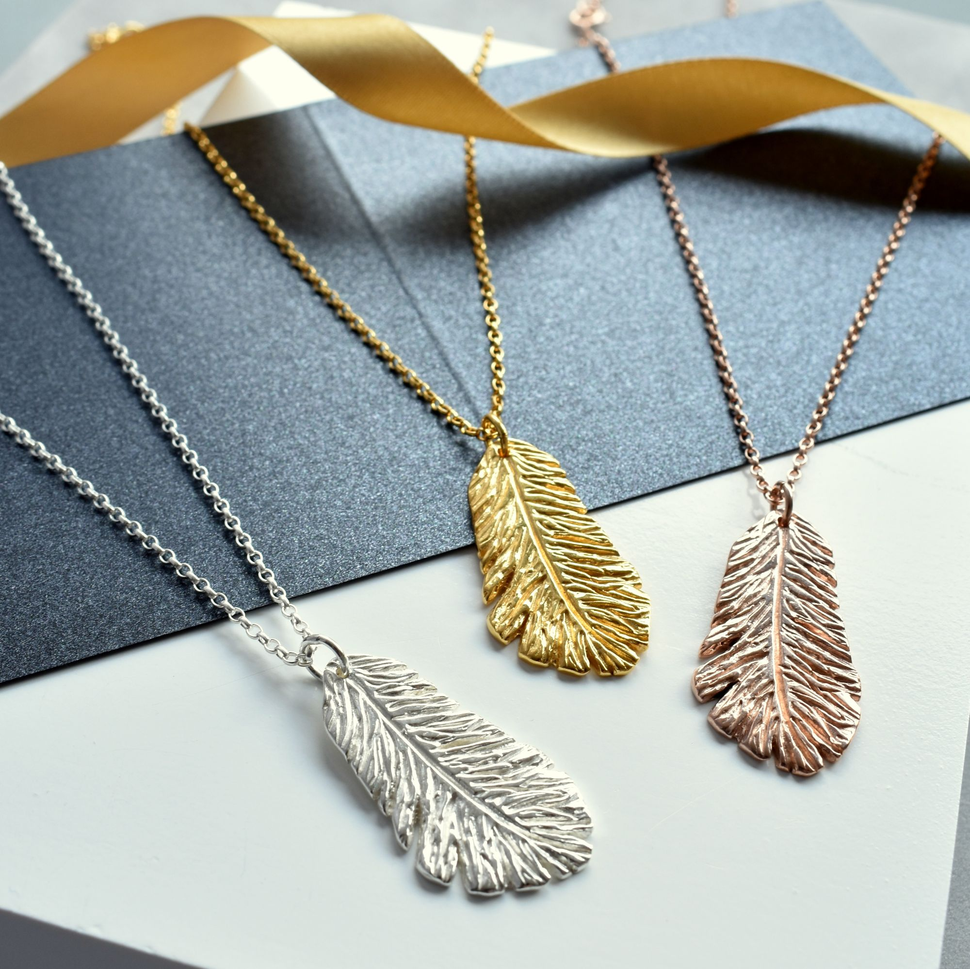 Silver, gold and Rose Feather Necklaces