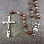 Dark brown oval wooden rosary beads with silver center 56cm length