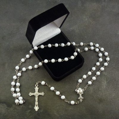 White round glass Communion rosary beads in a flocked gift box