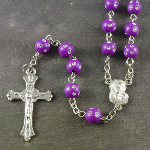 Purple plastic round rosary beads with silver spotted detail