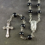Large black metal effect rosary with filigree covered paters