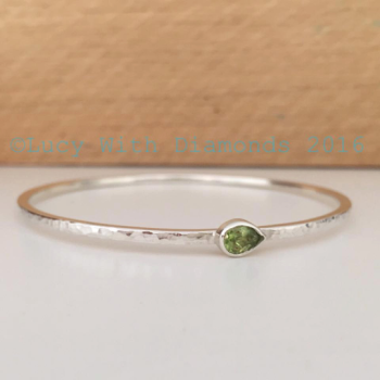 Sterling silver hammered finish bangle with pear shaped peridot gemstone august birthstone