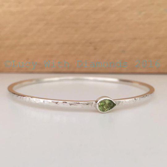 Sterling silver hammered finish bangle with pear shaped peridot gemstone au