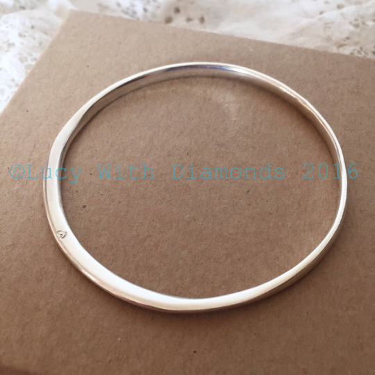 Silver polished bangle with heart contour bangle with heart star stamp vale