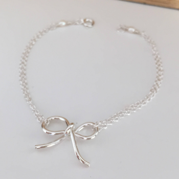 Handmade sterling silver bow on a chain bracelet with freshwater pearl