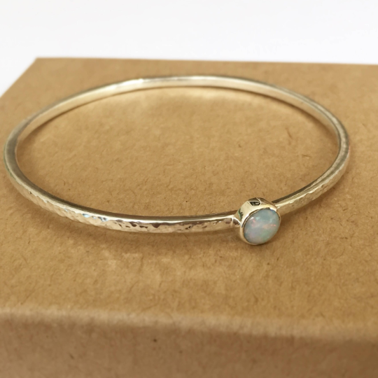 Sterling silver hammered finish bangle with opal