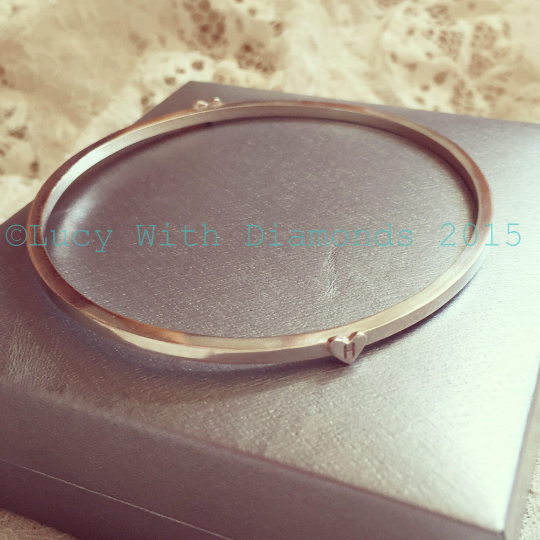 Stacking bangle in sterling silver with initial hearts