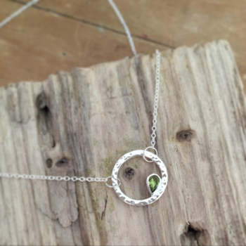 Circle necklace with pear shaped peridot with hammered finish in sterling silver