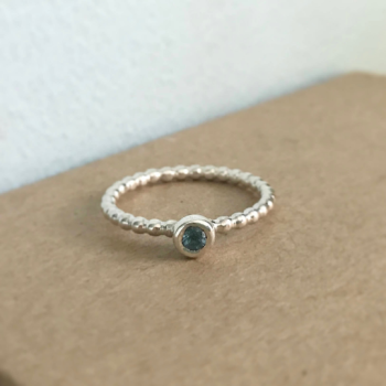 Beaded sterling silver stacking ring with London blue topaz