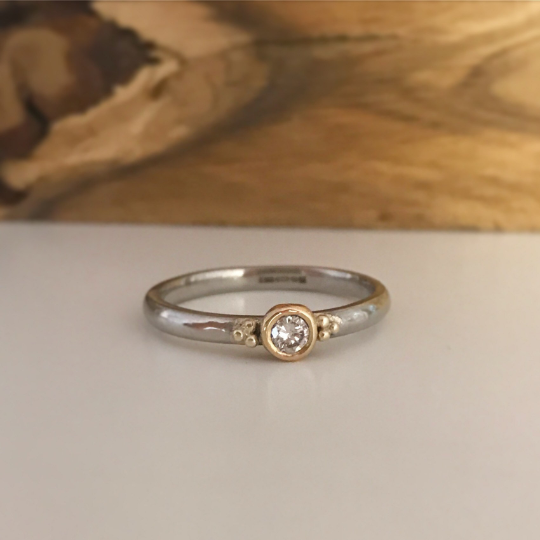 Diamond engagement ring set in 9ct rose gold and Palladium