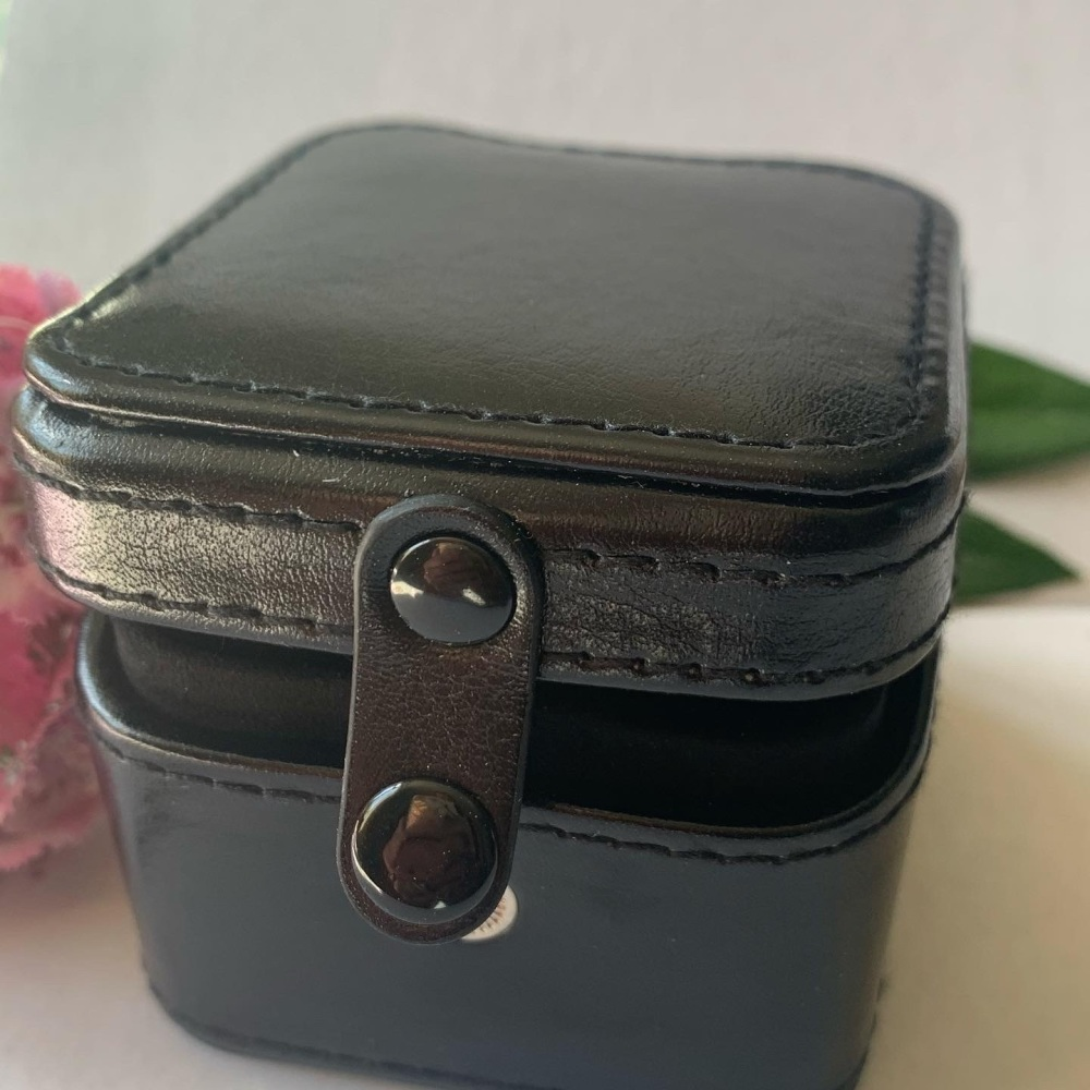 Black travel box for cufflinks and rings