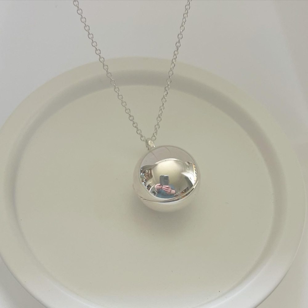 Sterling silver ball locket
