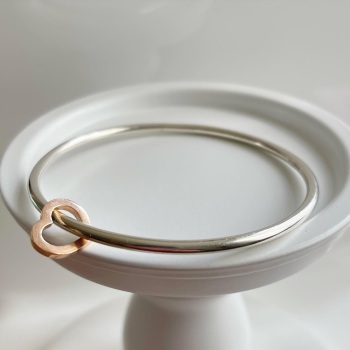 Sterling silver round wire bangle with 9ct Rose Gold heart