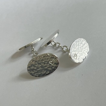 Oval hammered and polished cufflinks in sterling silver