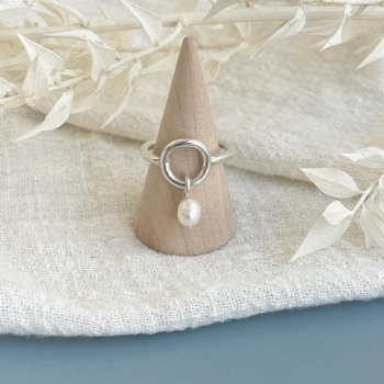 Circle and pearl drop ring in silver