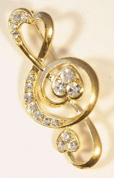 brooch treb clef gold