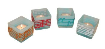 Tea light holder with music decoration
