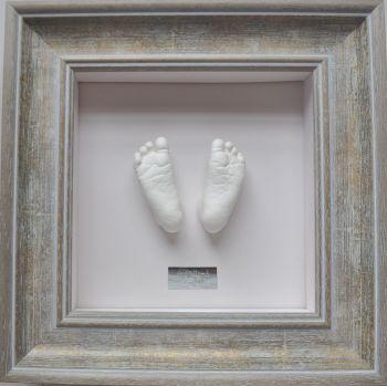 Plaster baby feet in Bevelled frame