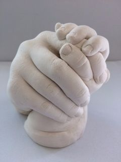 sibling holding hands in plaster