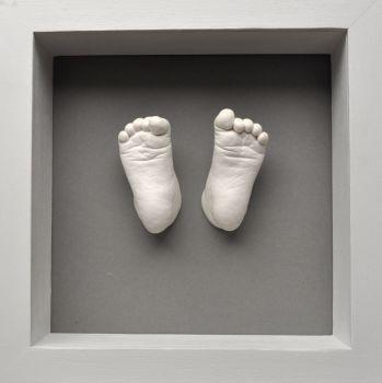 Plaster baby feet framed